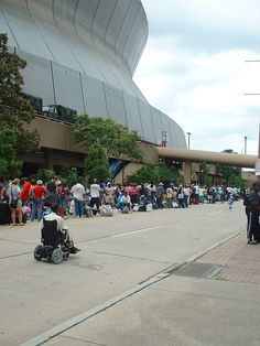 Displaced people bringing their belongings and lining up to get into the Superdome.