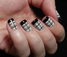 Plaid nail art design in black and white polish. In order to add more fascination with the design black polish is used to highlight the French tip on the nails.