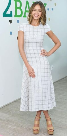 Jessica Alba wearing a windowpane Wes Gordon tweed dress, with strappy nude platforms.