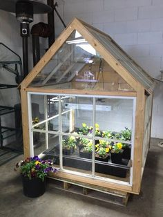 Résultat d'images pour greenhouse made from old windows Old Window Greenhouse, Old Windows, Backyard, Patio, Recycled Crafts, Hydroponics, Planting Flowers, Outdoor Living, Living Spaces