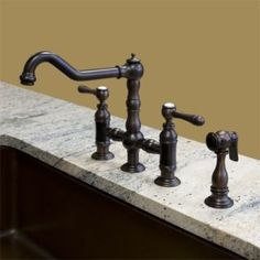 Canton Deck Mount Bridge Faucet with Handspray - Lever Handles - Oil Rubbed Bronze