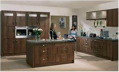 Bella Roma kitchen in Dark Walnut.  Traditional wood craftsmen used the deep colours, whorls and textures of dark walnut to accentuate their craft. Design grandeur, bringing together the traditional style and majesty for which Roma is renowned.
