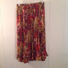 Fall colored flared skirt Fall skirt with shades of beige, golden, red, browns, and greens.  Flared style. White Stag Skirts