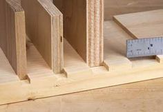 Tips on using a router to cut easy, accurate dado joints.