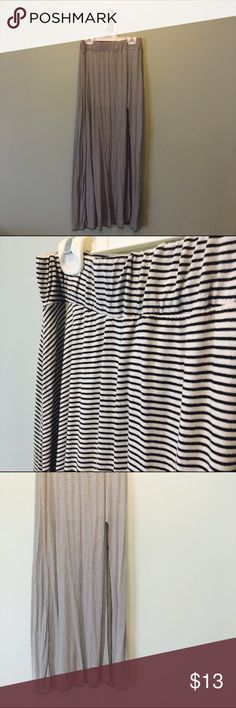 "NWT Brandy Melville Maxi Skirt!! Brand new Brandy Melville maxi skirt | Black and white vertical stripes | Two slits in the front | Elastic waste band | Incredibly soft material | Says one size fits ""all"", but would fit around a size small 