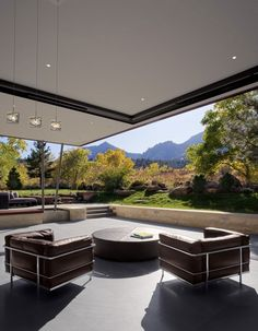 Modern Mountain Home in Boulder -  indoor/outdoor living space with hugs sliding windows.  That's fresh air, folks!