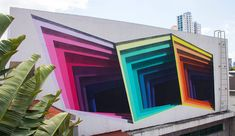 Brand new Murals by '1010' Expose Hidden Portals of Color in Walls and Buildings - Cretíque