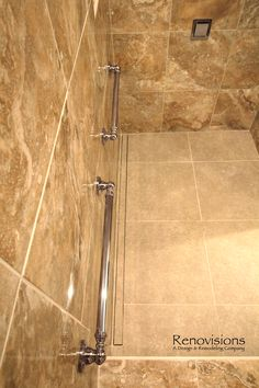Master bathroom remodel by Renovisions. Tile shower, safety grab bars, walk-in shower, lineal drain...