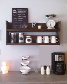 """The beautiful rustic kitchen shelf is made from reclaimed wood that is stained and distressed. It measures 35 x 10 x 14"""". Great for kitchen storage! I used this above my coffee bar as it is great for holding canisters of coffee, mugs and cookbooks. This shelf comes with 4 hooks for coffee mugs underneath the shelf. Can be stained any color, please convo me with questions. Reclaimed Wood Shelves, Rustic Shelves, Wood Shelf, Wall Wood, Rustic Cabinets, Rustic Bench, Rustic Outdoor, Rustic Barn, Rustic Modern"""