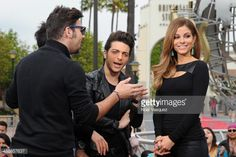 Il Volo sing to Maria Menounos at 'Extra' at Universal Studios Hollywood on November 20, 2013 in Los Angeles, California.