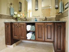Incredible after picture.  Great idea for the typical builder's special.  After: Classic, Stylish Vanity - Traditional, Luxurious Master Bathroom on HGTV