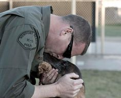 Have you kissed your dog today ?   K9 Commando shared Orange County Police Canine Associations photo .