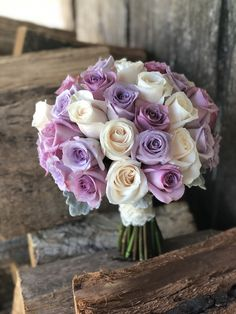 Bridal bouquet of ivory, mauve and lilac roses, created by Lovely Bridal Blooms