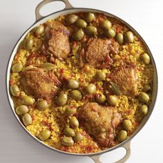 The bold flavors of saffron, bay leaves, and garlic infuse Valencia rice, a Spanish variety perfect for slow-cooked dishes (it is the traditional base for paella). Here, the grains are cooked up with golden-brown chicken thighs and garnished with pimiento-stuffed olives. Saffron gives the rice its warm yellow hue.