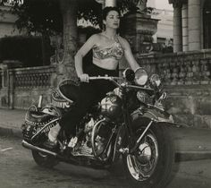 Lina Salomé , Cuban singer and dancer, zooms around Havana in 1956.