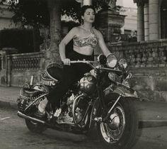 Lina Salomé , Cuban singer and dancer, zooms around Havana in 1956.