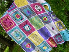 Finished Square a Day in May Blanket. Her colors are beautiful! Maybe someday I'll finish mine :)