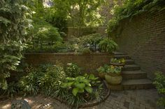 hidden garden / secret garden in Massachusetts. I would love to have a walk-out basement where you walk out into a sunken garden like this.(I don't know if the real one is actually sunken or just walled. Garden On A Hill, Garden Club, Garden Paths, Boston Garden, Garden Stairs, Sunken Garden, Hidden Garden, Landscaping Work, Beacon Hill