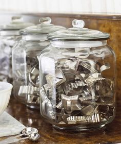 Apothecary jars make elegant storage solution to display your cookie cutters collection. Note that it looks better when all your cookie cutters are made of tin or copper. Not so cute with plastic ones. Via House and Home. Kitchen Organization, Organization Hacks, Kitchen Storage, Kitchen Decor, Kitchen Display, Baking Storage, Storage Jars, Pantry Storage, Closet Storage