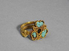 Ring; Yuan dynasty (1271–1368), China. Gold, malachite, glass, and pearl; Diam. 7/8 in. (2.3 cm). Lent by Hebei Institute of Cultural Relics