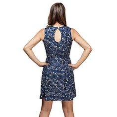 Navy blue knee-length dress with a star field and constellations that glow in the dark, so that you can be the center of attention, day or night. Fitted bodice with a flared skirt, with a button closure keyhole back and zipper.