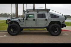 Hummer. The wheels would be replaced with the traditional military steel wheels in black, but this is exactly how I would have it.