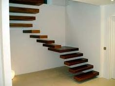 Floating wood staircase. Homesandlifestylemedia.com #staircase #unique #cool #architecture #design #home #house