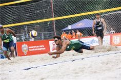 Italy's Alex Ranghieri above the sand watched by partner Adrian Carambula