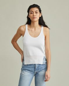 Knit tank top with rib knit trim and side vents. Silky hand feel Knit trim Side vents rayon Model is 175 ft 9 in and is wearing an IT size 38 Retail Concepts, Knitted Tank Top, Cool Suits, Apothecary, Designing Women, Rib Knit, Basic Tank Top, Tank Tops