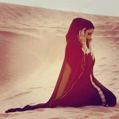 She hides her face but with her eyes wide open to show the sorrow and the pain she kneels down to pray.  (Violet)