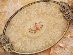 Beautiful vanity tray with lace insert I have one much like this. It's packed away in a box...maybe it's time to bring it out again.