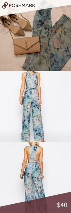 """ASOS Delicate floral printed jumpsuit Pretty floral and pale blue jumpsuit with deep side cuts in the back. Wide pant leg and middle back zipper. Fits best for size 24"""" waist. ASOS Pants Jumpsuits & Rompers"""