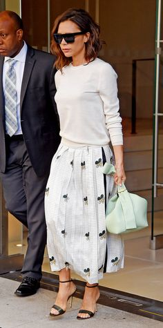 Low-key but ladylike, this sweater/skirt combination from Victoria Beckham works well for the office. If high heels aren't your thing, simply swap in flat mules.