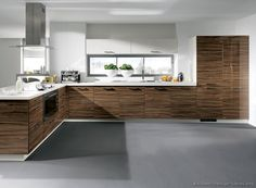 #Kitchen Idea of the Day: Modern Two-Tone Kitchen (By ALNO, AG) with horizontal grain dark wood cabinets and gray floors.