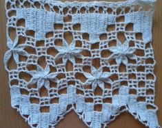 Handmade lace crochet trim. A gorgeous model crocheted lace edge. You can use this crocheted filet lace for decorating curtains, tablecloths, bedspreads, or for any other project that will make your home unique. Can be a great gift for a new home.  MADE TO ORDER by me ,using fine and high quality mercerized cotton- product in Romania. Available colors: white, ecru, beige.  Dimensions: - height 13,5 cm (approx. 5.3 inch) - length on request; Price is for 50 cm of lace( 19.7 inch/), heig...