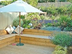 adding step in wood deck for sloped yard gives built-in extra seating