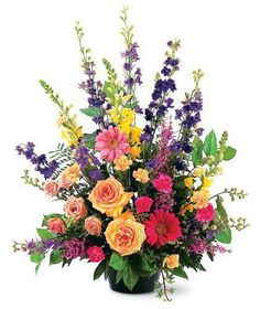 """Colorful Tribute Sympathy Arrangement-A stylish tribute of brillant flowers ideal for the funeral home, service or home. These tall graceful designs are in a solid container, at least 24"""" high with your choice of flowers and colors. Can be placed on the floor, table or column. #BillyHeromans #BatonRougeFlorist #SympathyFlowers"""