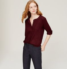 In pure cotton, polka dots get all grown up. Collarless. Long sleeves with button cuffs. Henley button placket with bottom pleat. Box pleat beneath back yoke. Shirttail hem.