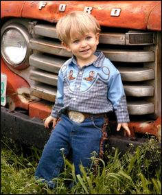 Precious little guy!  Love his outfit for pictures and the old truck.