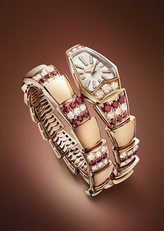 The second model of the limited edition Bulgari Serpenti watch features a one-coil bracelet with a case shaped like a snake's head, which is set on either side with six brilliant cut diamonds, a white mother-of-pearl dial and 33 diamond indexes. - photo via Lifestyle Asia