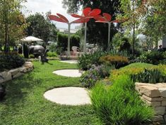 Round stepping stones for garden best home design ideas a prize winning garden at the melbourne garden show large round stepping stones lead workwithnaturefo