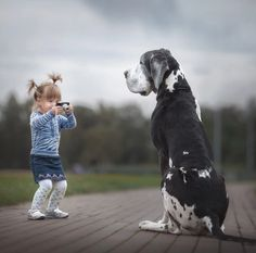 """Heartwarming photos of little kids with huge dogs as part of a collection from Russian photographer Andy Seliverstoff's book """"Little Kids and Their Big Dogs. Dogs And Kids, Animals For Kids, Animals And Pets, Dogs And Puppies, Cute Animals, Doggies, Corgi Puppies, Baby Dogs, Nature Animals"""