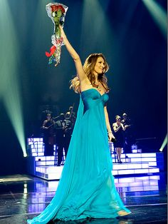 Celine Dion in dazzling waterfall blue Versace dress--love it, love the shade of the blue, love the dress's flow and movement.