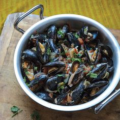 Malabar Mussels | In this Anglo-Indian recipe from cookbook author and cooking instructor Smita Chandra, mussels gathered from local waters are cooked with tomatoes in a richly spiced coconut broth.