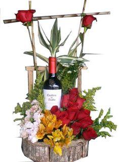 Resultado de imagen para arreglos florales con botellas de vino #Arreglosfloralesparamesa