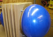 Once you have enough ply layers, insert giant gym ball and blow up. Leave until set