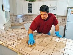 Install Tile Over Laminate backsplash. laminates are typically made from nonporous materials. In order to make thin-set adhere to that surface, make the laminate more porous by using an electric sander to sand its surface. Beadboard Backsplash, Laminate Countertops, Concrete Countertops, Kitchen Countertops, Backsplash Ideas, Diy Counters, Blue Backsplash, Herringbone Backsplash, Kitchen Redo