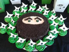Ninja cake with ninja star cupcakes!  Ninja made with crushed oreos
