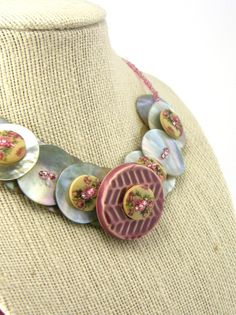 Pink Flower Button Necklace / by TrinketsNWhatnots