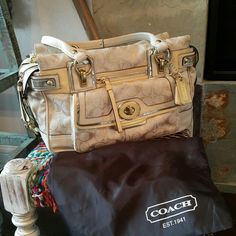 "Coach shoudler handbag Preloved gold and white Coach handbag. Very good condition. Dust bag included. Approximately size 14""x 8""x 5"". No PayPal and no trade. Accept reasonable offer. Coach Bags"